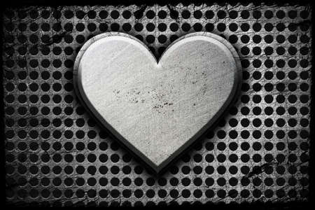 Metal heart on a metal background Stock Photo - 12691140