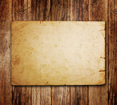 the western wall: Old paper on the wood background Stock Photo