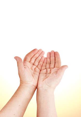 faithful: Praying hands of an old woman