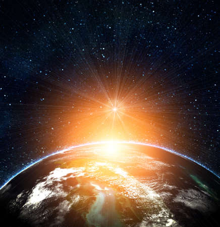 blue earth in space with rising sun Stock Photo - 12695009
