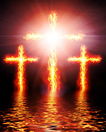 heaven and hell: cross burning in fire Stock Photo