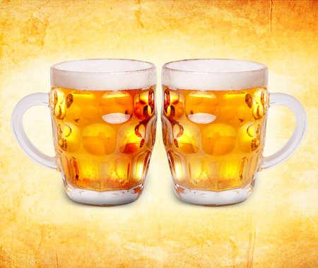 Beer mugs on the grunge background photo