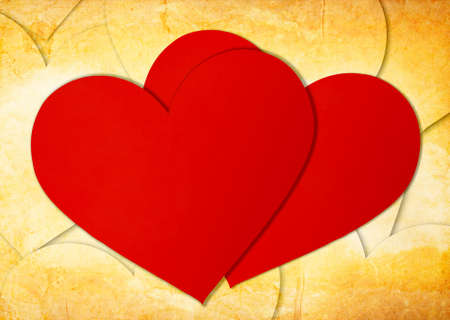 two red paper hearts on grunge photo