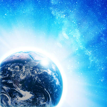 blue earth in space with rising sun Stock Photo - 12695409