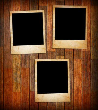 Grunge vintage photo frames on a wood texture background photo