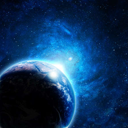blue earth in space with rising sun Stock Photo - 12697047