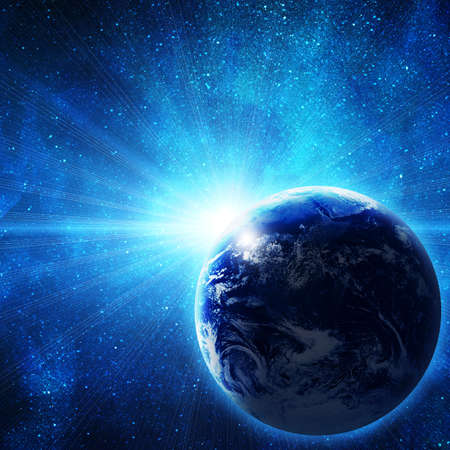 tierra en el espacio con el sol naciente Foto de archivo