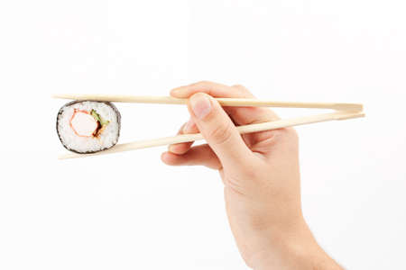 makki: Sushi in a hand on a white background