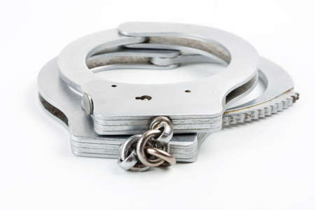 Handcuffs isolated on a white background photo