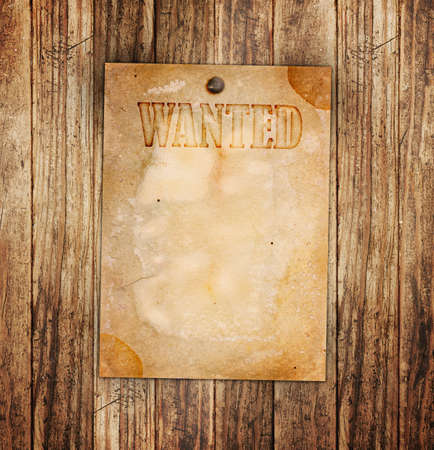 Vintage wanted poster on a wooden wall photo