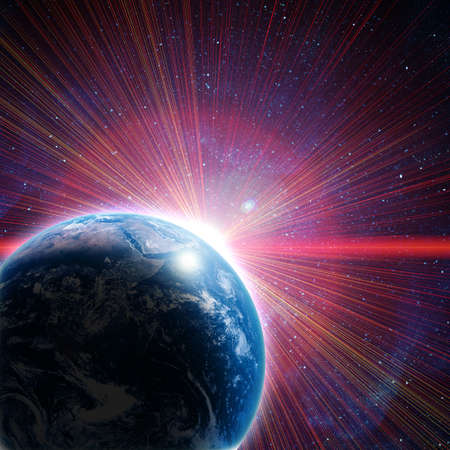 blue earth in space with red rising sun photo