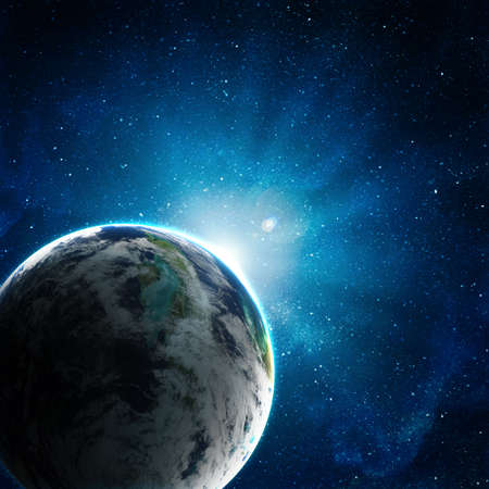 blue earth in space with rising sun Stock Photo - 12705548