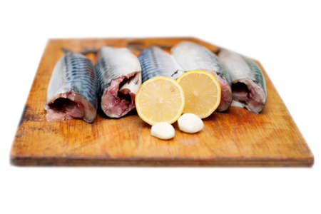 hardboard: isolated fish carcass with spices on wooden hardboard, prepared for cooking