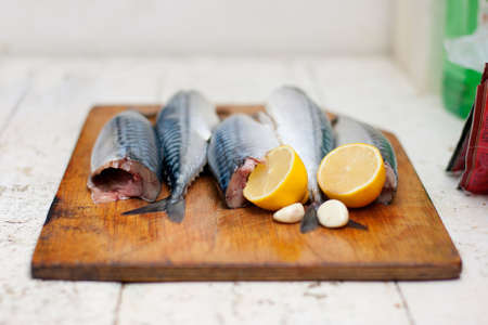 hardboard: Fish carcass with spices on wooden hardboard, prepared for cooking