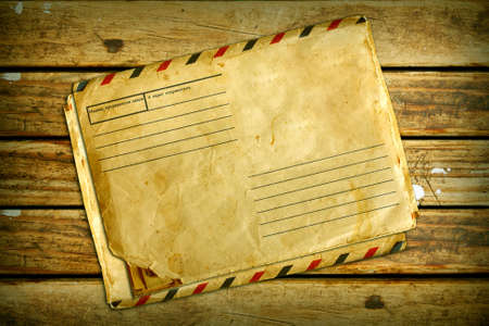 vintage air envelope on old wood texture photo