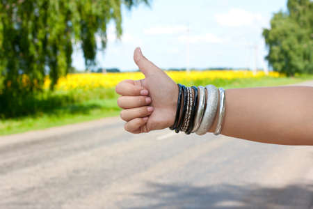 hitch hiker: hitchhiking the road Stock Photo