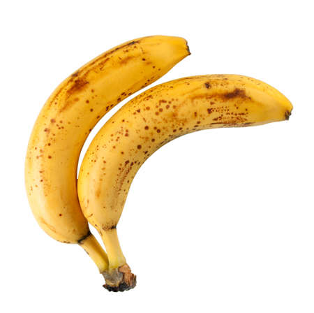 spotty: Old yellow bananas isolated on white background