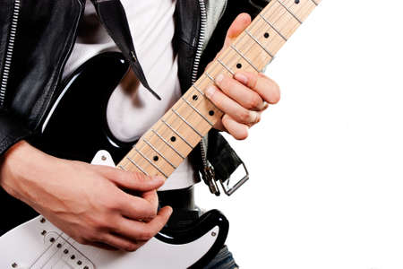onstage: Guitarist playing on electric guitar isolated on white background