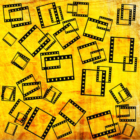 film pieces on orange grunge background photo