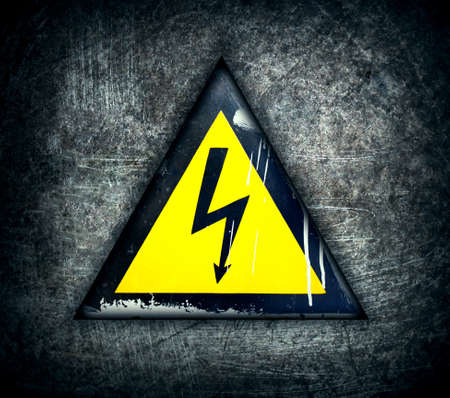 symbol of high voltage on a steel background Stock Photo - 12704437