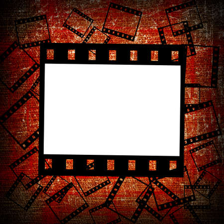 foto: film pieces on red grunge background Stock Photo