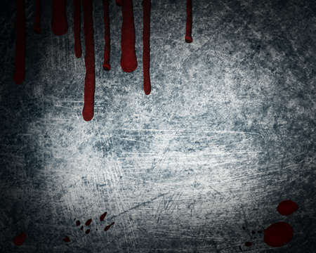 steel background with drop of blood photo