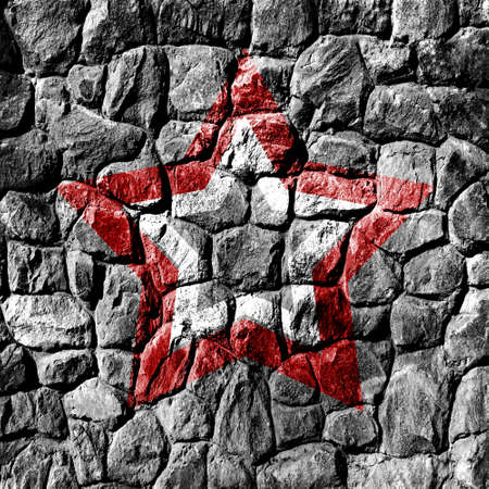 corrode: grunge stone wall with red and white star