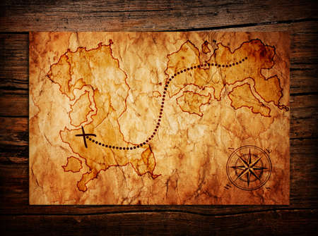 old treasure map on wooden background photo