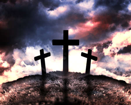 Silhouette of three crosses on a hill with a moon behind them photo