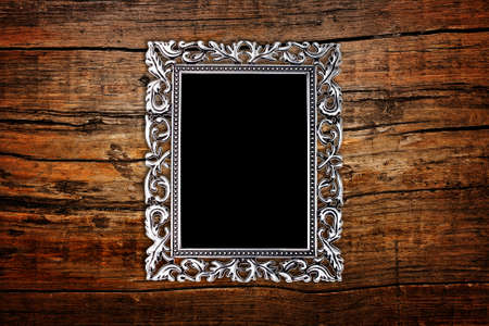 plated: silver frame on a wood background