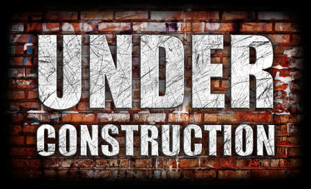 Under Construction on brick wall photo
