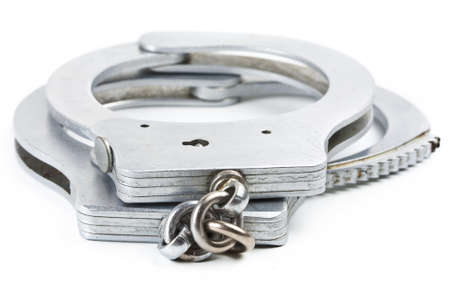 Photo of a pair of handcuffs isolated on a white background Stock Photo - 13278799