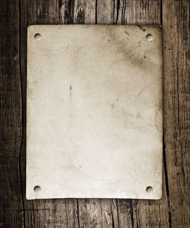 curled: Old vintage poster on wooden background