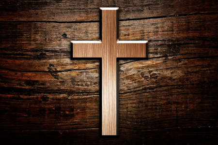 cross on wood background photo