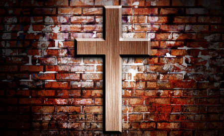 hope symbol of light: Wooden crucifix on the brick wall lighting by spotlight