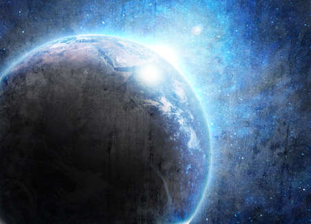 blue earth in space with rising sun photo
