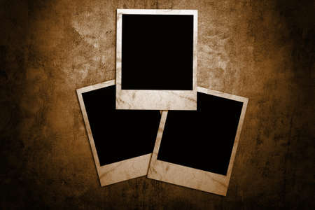 Aged photo frames on grunge background photo