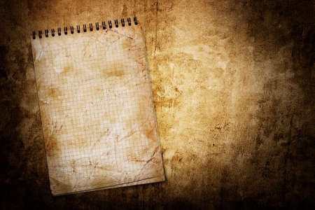 infamous: old used notebook on grunge background Stock Photo