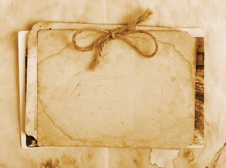 photo album page: Vintage background with old paper, letters and photos