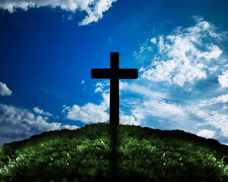 Silhouette of cross on a hill Stock Photo - 14041245