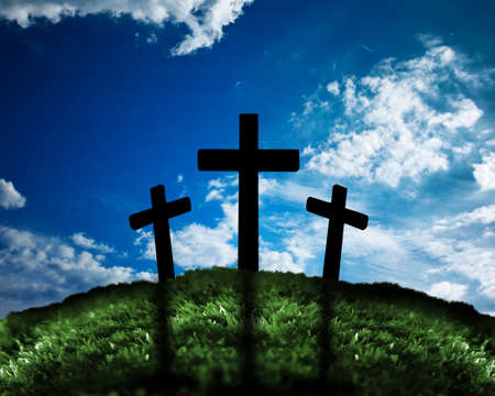 Silhouette of three crosses on a hill photo