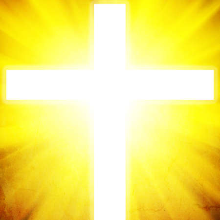 Glowing cross on a black background, with radial rays of light Stock Photo