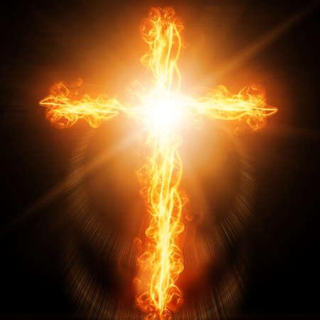 easter cross: cross burning in fire Stock Photo