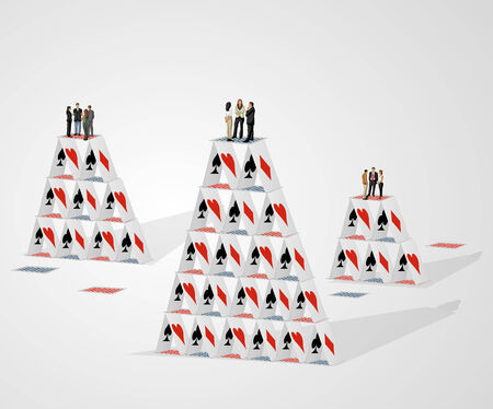 Business people over castle of cards Stock Vector - 25302679