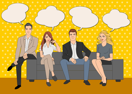Group of business people talking seated on a sofa