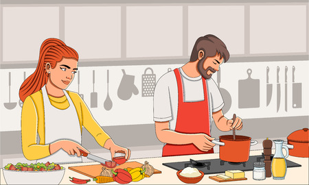Couple wearing apron and cooking. Chef in the kitchen.