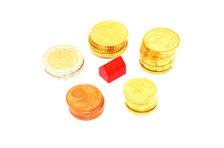 mortgaging: Miniature red house and euro coins Stock Photo