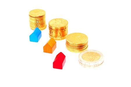 mortgaging: Miniature houses and euro coins Stock Photo