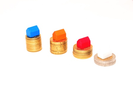 small houses on the coins Stock Photo - 13577908