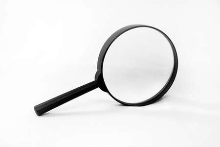 Magnifying glass on white background closeup Stock Photo - 8399827